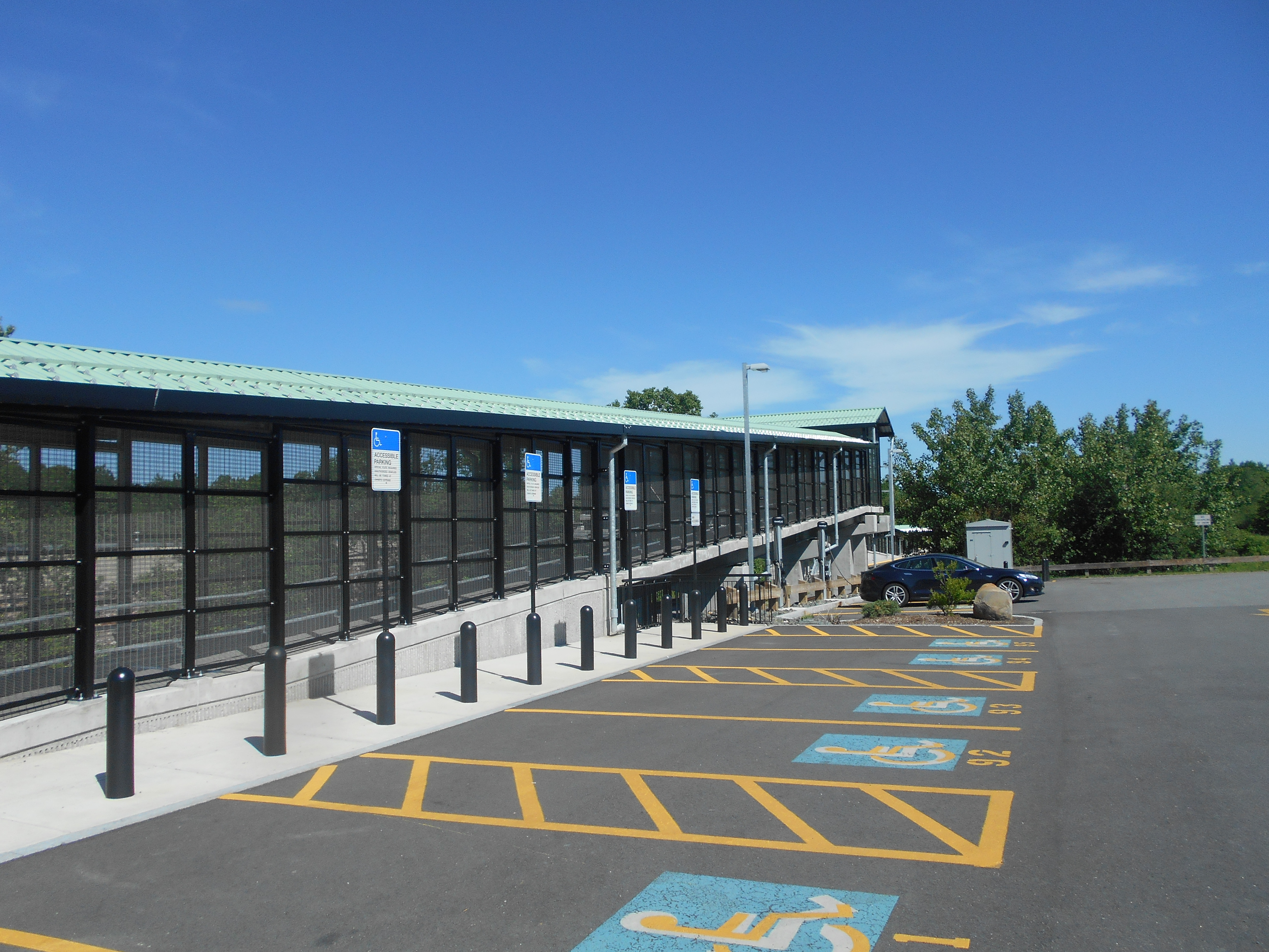 File Handicapped parking and ramp at Littleton station jpg. File Handicapped parking and ramp at Littleton station jpg