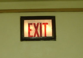 English: An old exit sign that does not meet m...