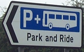 A road sign for park and ride.