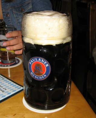 A picture of Paulaner dunkel, a dark lager beer.