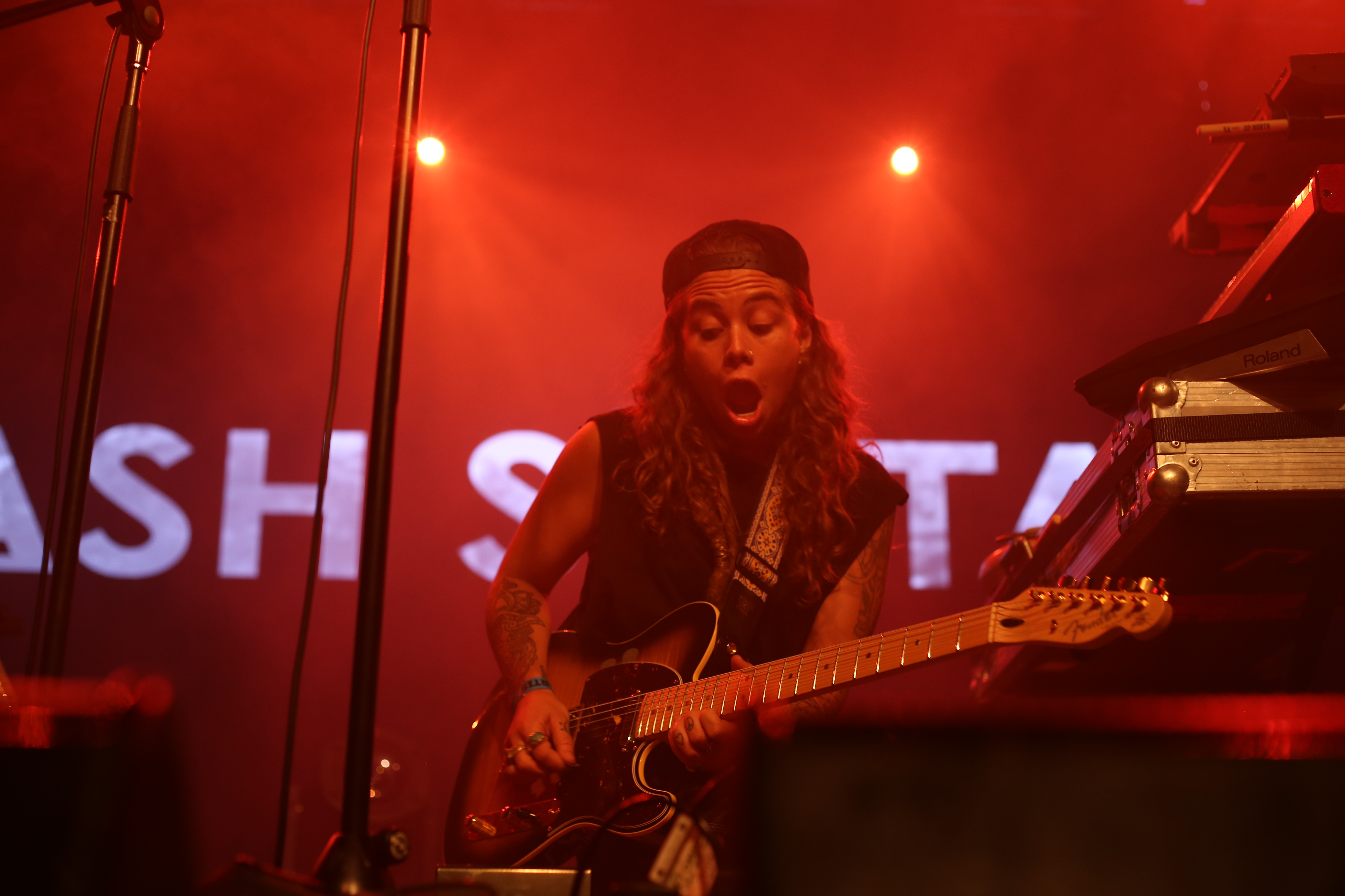 Sultana playing guitar at a live performance in Melbourne 376276a359a4