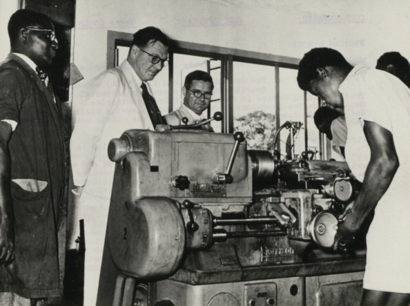 Lord Listowel watches fourth-year boys operating lathes at the Trade Training Centre in Tamale, Northern territories. This Centre provided four-year courses for boys leaving middle schools and evening classes for those who go from the middle schools into industry The National Archives UK - CO 1069-46-53.jpg
