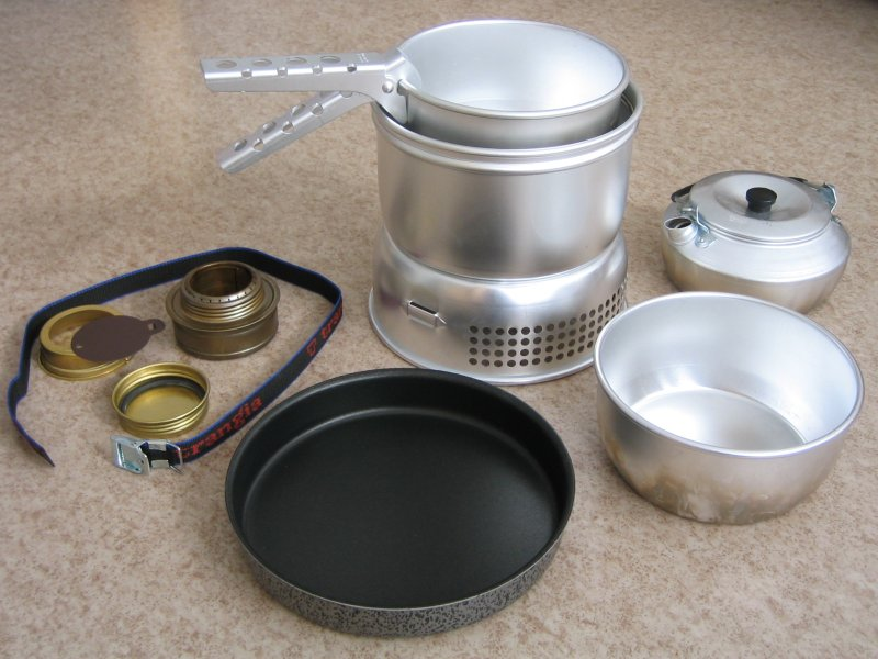 Trangia camping stove with fuel element, pans, kettle, strap and handle