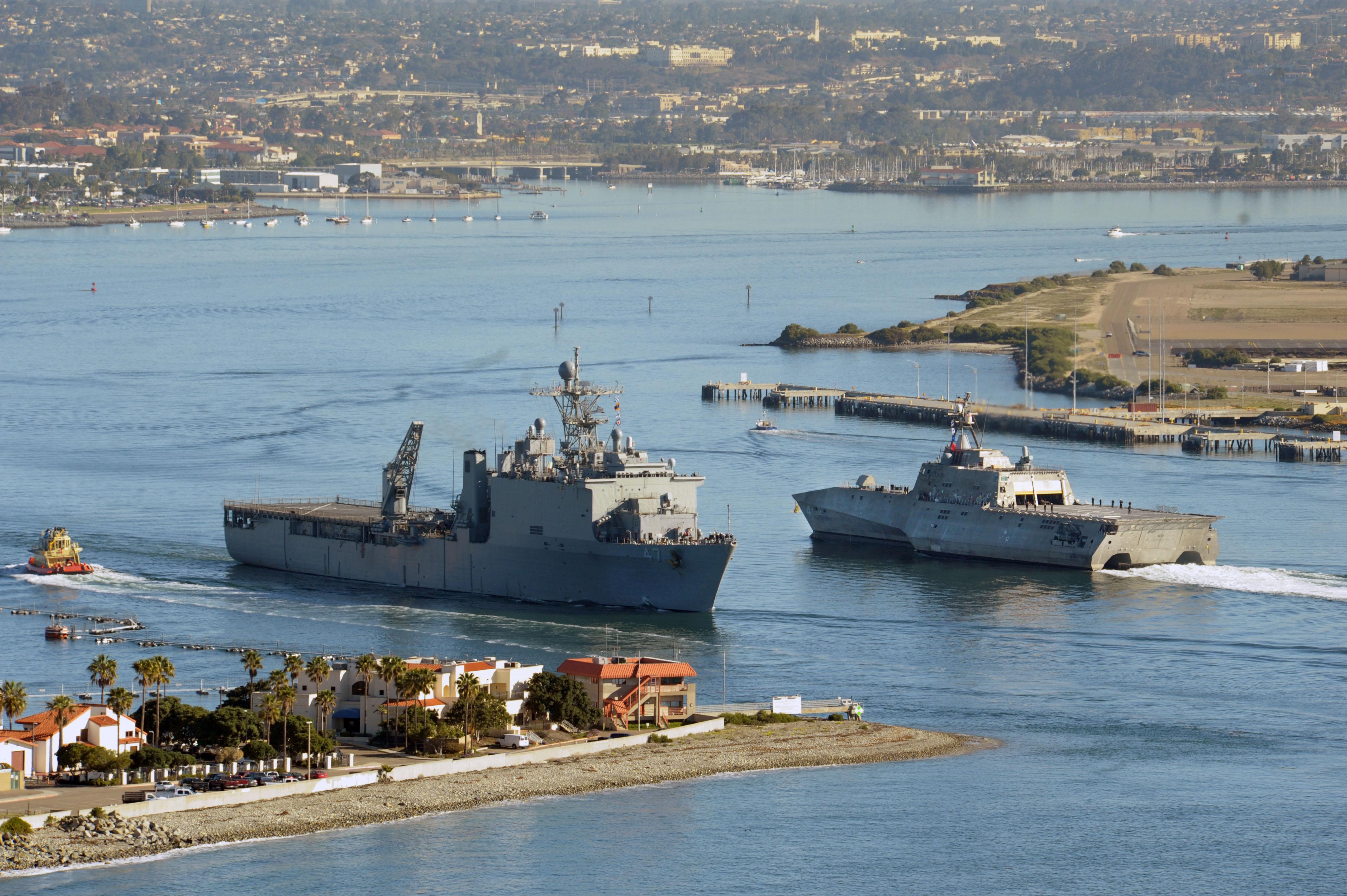 USS Rushmore (LSD 47) passes PCU Coronado (LCS 4).jpg