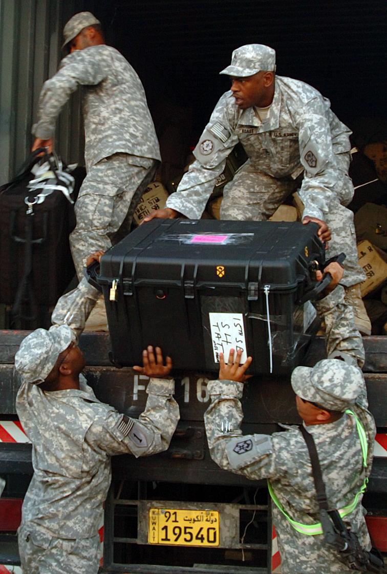 File:US Army 50878 Staff Sgt. Ronald Boast hands a tough ...