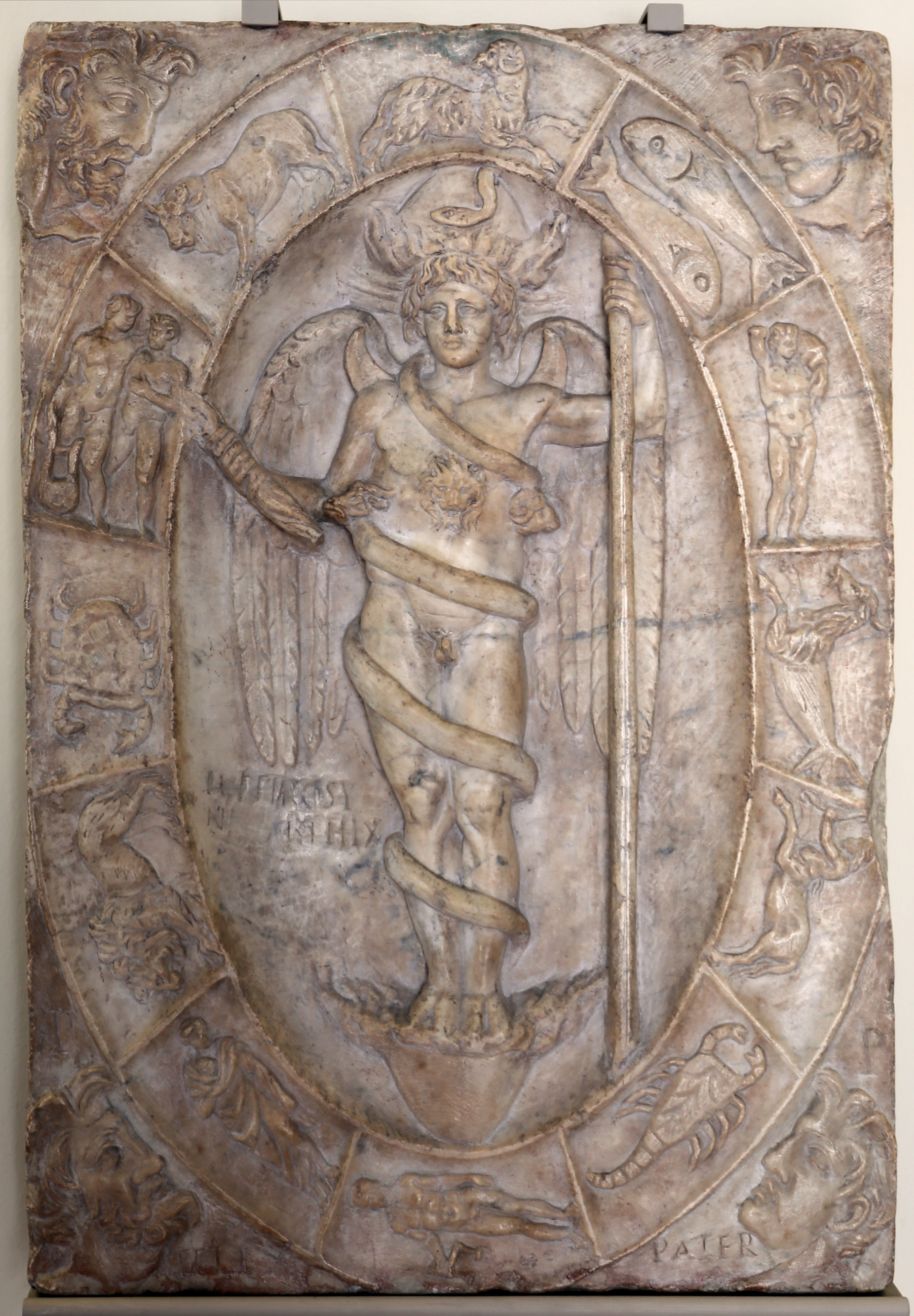 https://upload.wikimedia.org/wikipedia/commons/5/53/Arte_romana%2C_rilievo_con_aion-phanes_entro_lo_zodiaco%2C_150_dc_ca.%2C_probabilmente_da_un_mitreo.jpg