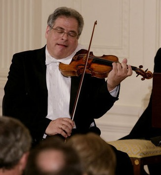 Itzhak Perlman, a polio survivor, plays the vi...