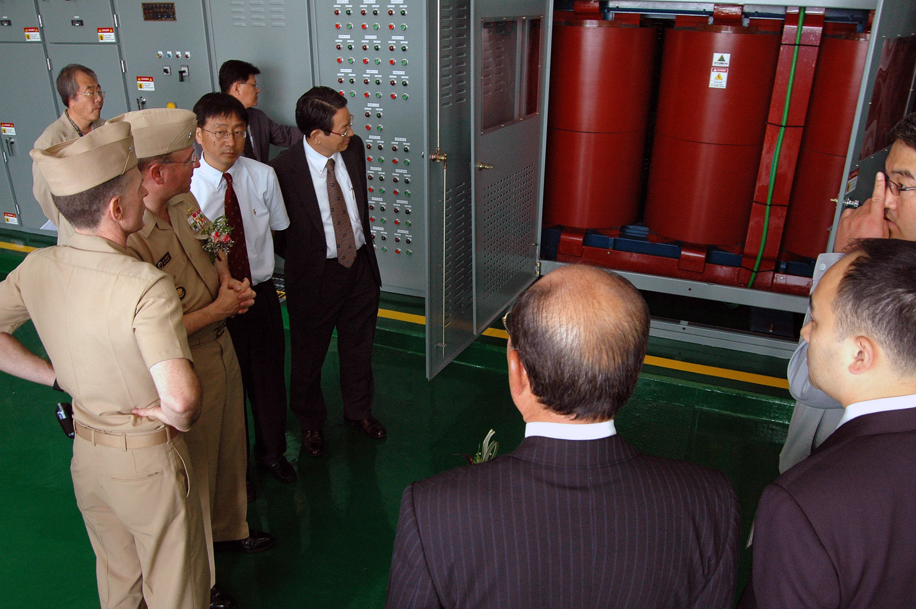 US Navy 070605-N-0021M-003 Rear Admiral James p. Wisecup along with members of the Seo Kwang Development Company and the Republic of Korea Navy are shown the newest additions to Pier 11.jpg
