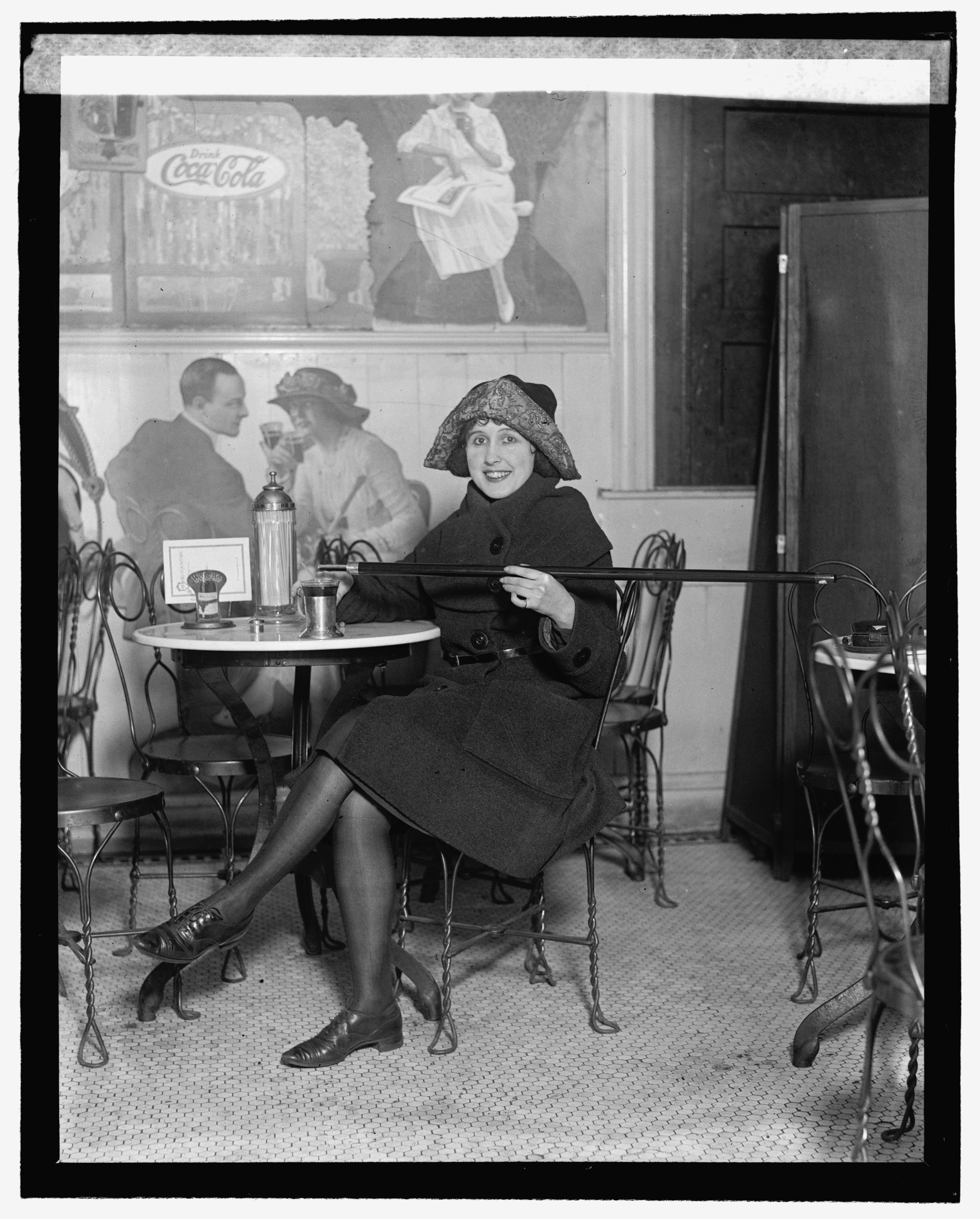 File Woman Seated At A Soda Fountain
