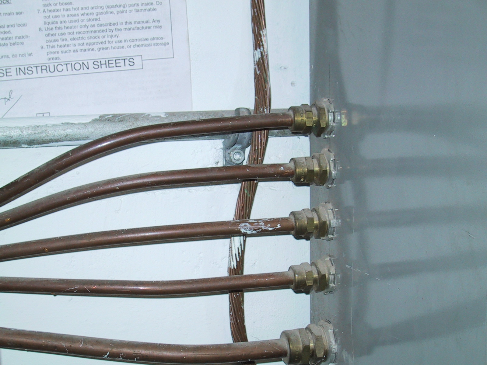Mineral Insulated Copper Clad Cable Wikipedia Code Check Electrical Hundreds Of Nec Facts At Your Five Metal Covered Cables Enter The Left Side An Panel Through Brass Fittings