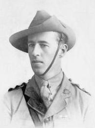 Head and shoulders of a young man in a shirt, tie, and slouch hat