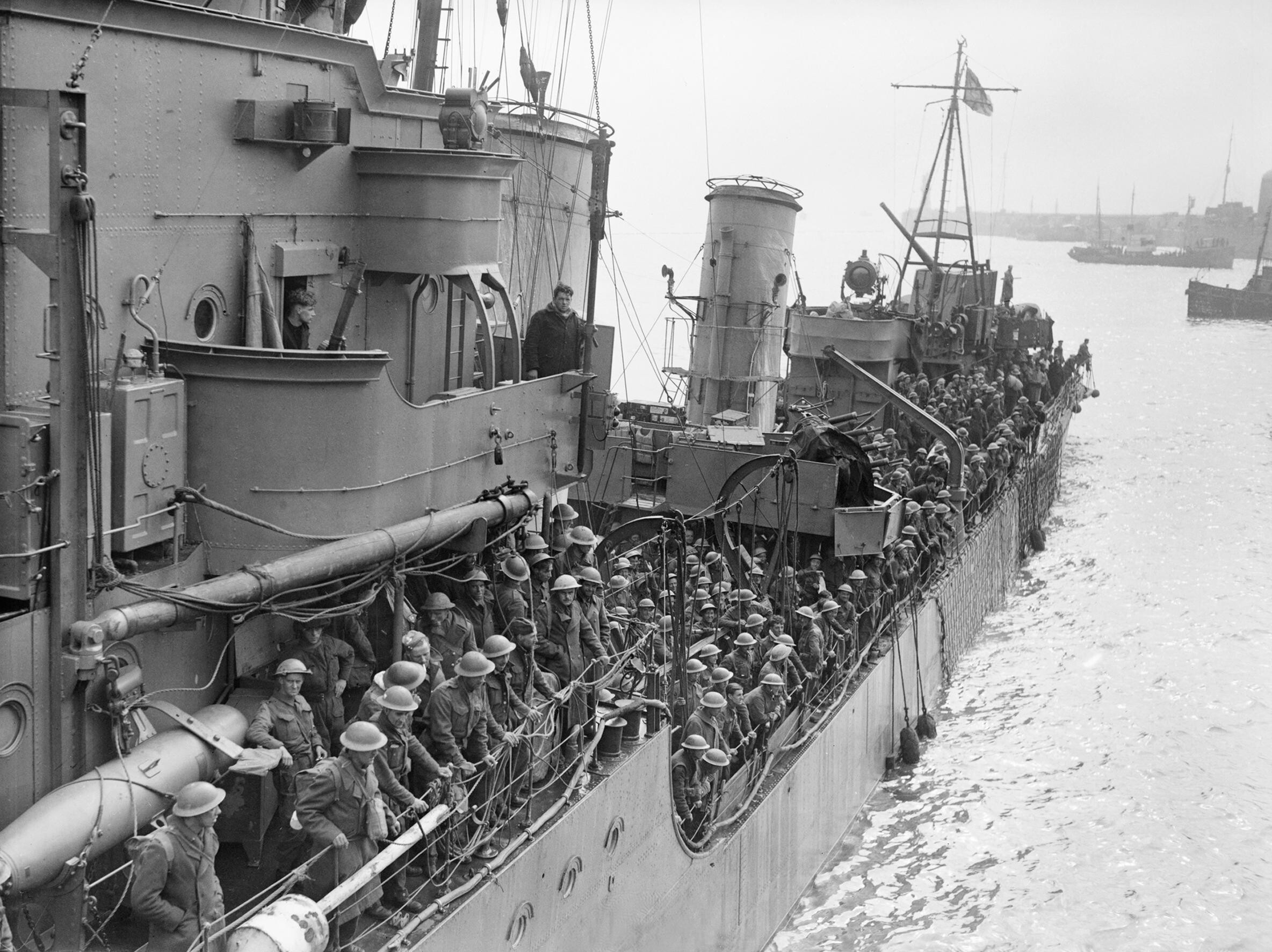 Troops evacuated from Dunkirk on a destroyer about to berth at Dover, 31 May 1940. H1637