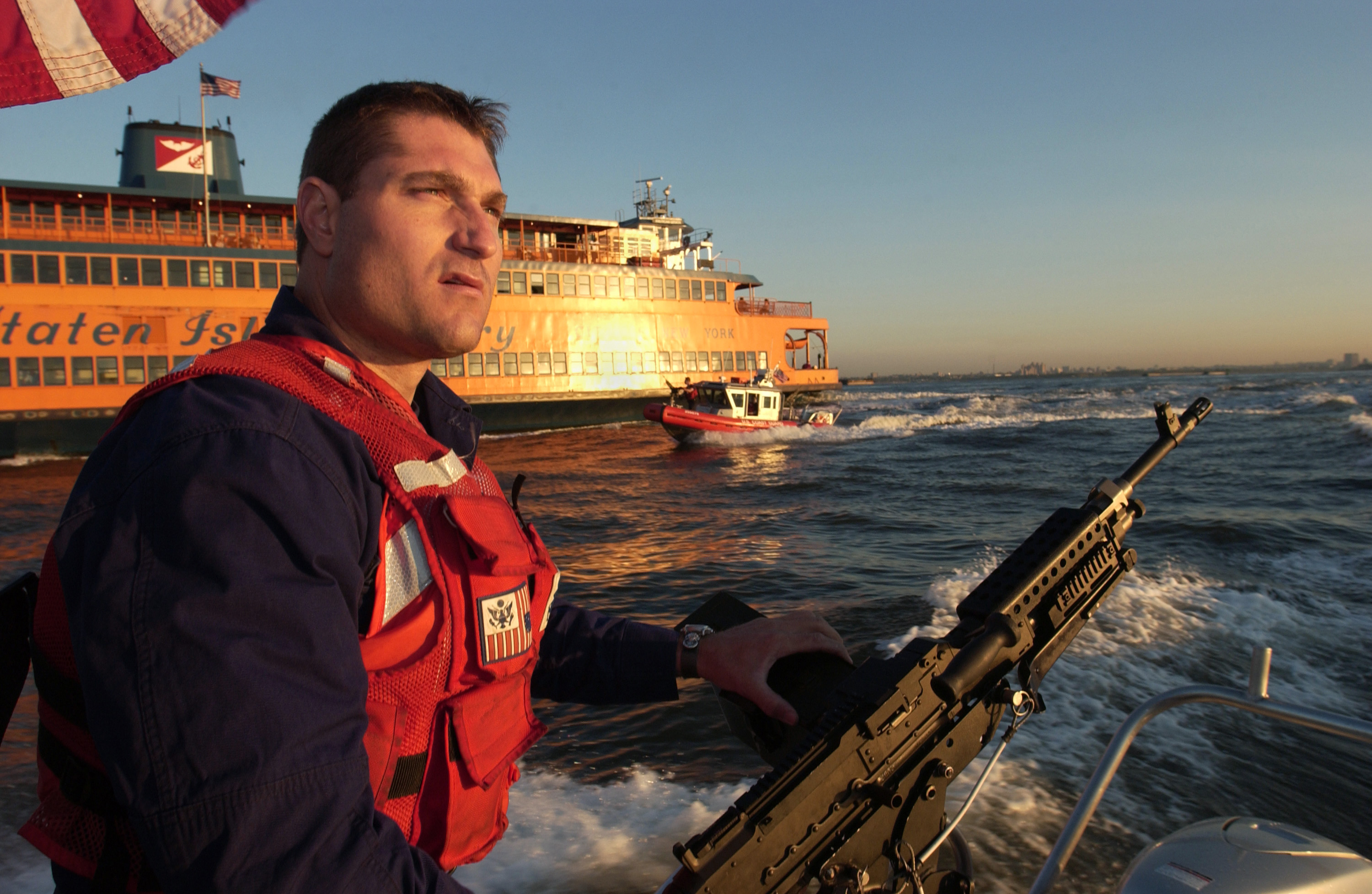 Fileus Navy B 001 Petty Officer 3rd Class Maurice Orlando From San Diego Calif Keeps A Sharp Eye On Boat Traffic While Security Boats From