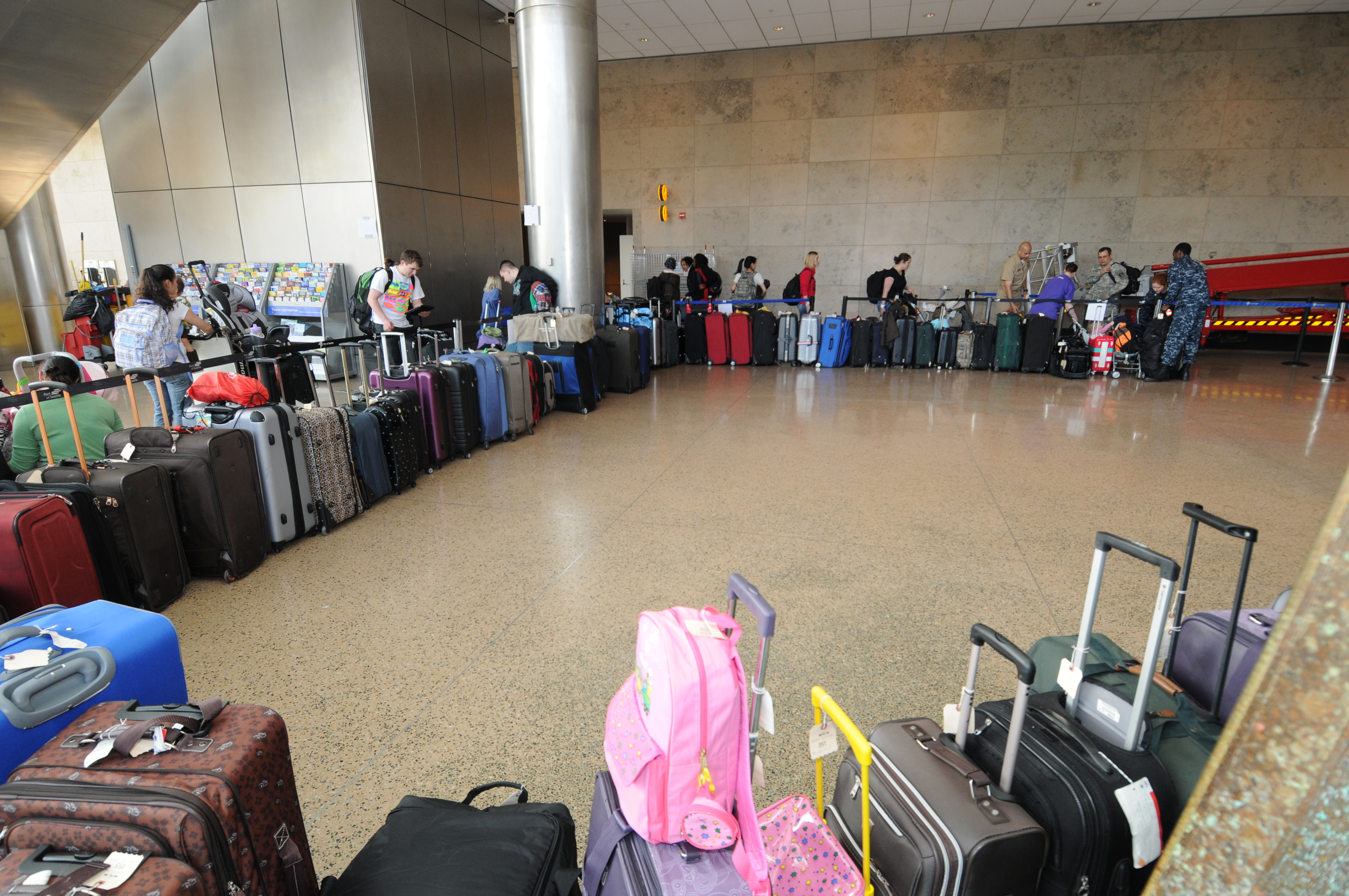 File:US Navy 110322-N-AE328-011 Luggage starts to pile up as ...