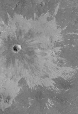 Bright rays caused by impact throwing out a bright lower layer. Some bright layers contain hydrated minerals. Picture taken with Mars Global Surveyor, under the MOC Public Targeting Program.
