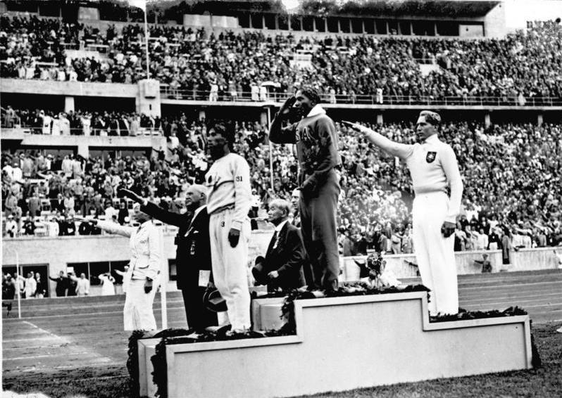 jesse owens jesse owens on the podium after winning the long jump at the 1936 summer olympics l r naoto tajima owens lutz long