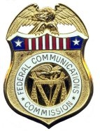 From commons.wikimedia.org/wiki/File:Federal_Communications_Commission_Inspector_General_badge_(USA).jpg: Federal Communications Commission Inspector General badge