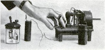 Hughes wireless apparatus, a clockwork driven spark transmitter and battery (right) and a modified version of his carbon block microphone (left) which he used in his 1879 experiments. Hughes wireless apparatus.jpg