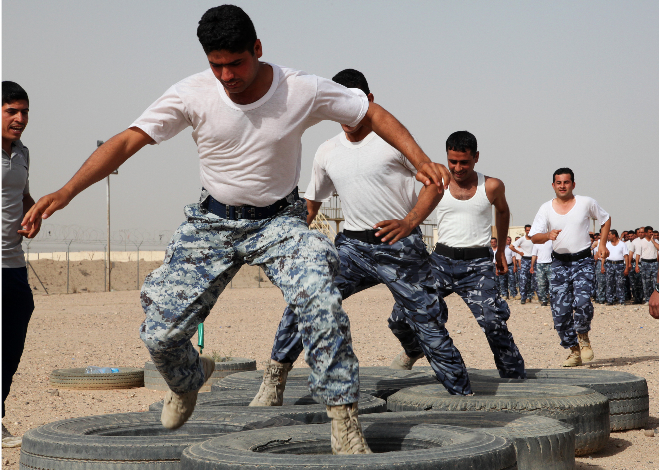 file iraqi police and border patrol officers run through