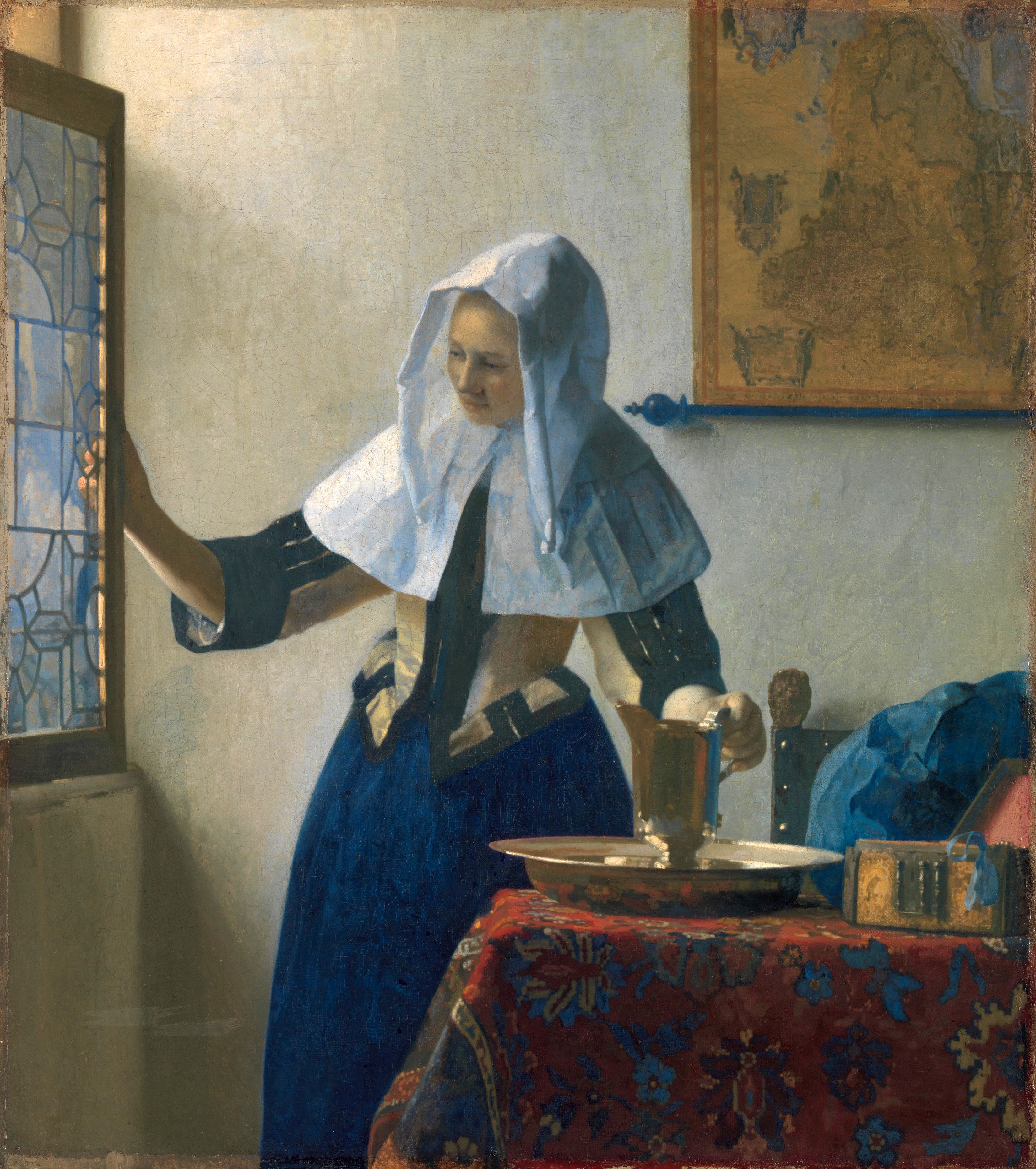 Young Woman with a Water Pitcher by Johannes Vermeer.