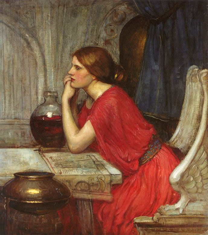 woman in deep red dress seated at table