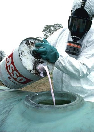 Preparation for an application of hazardous herbicide in the US Monsanto's Lasso herbicide (cropped).jpg