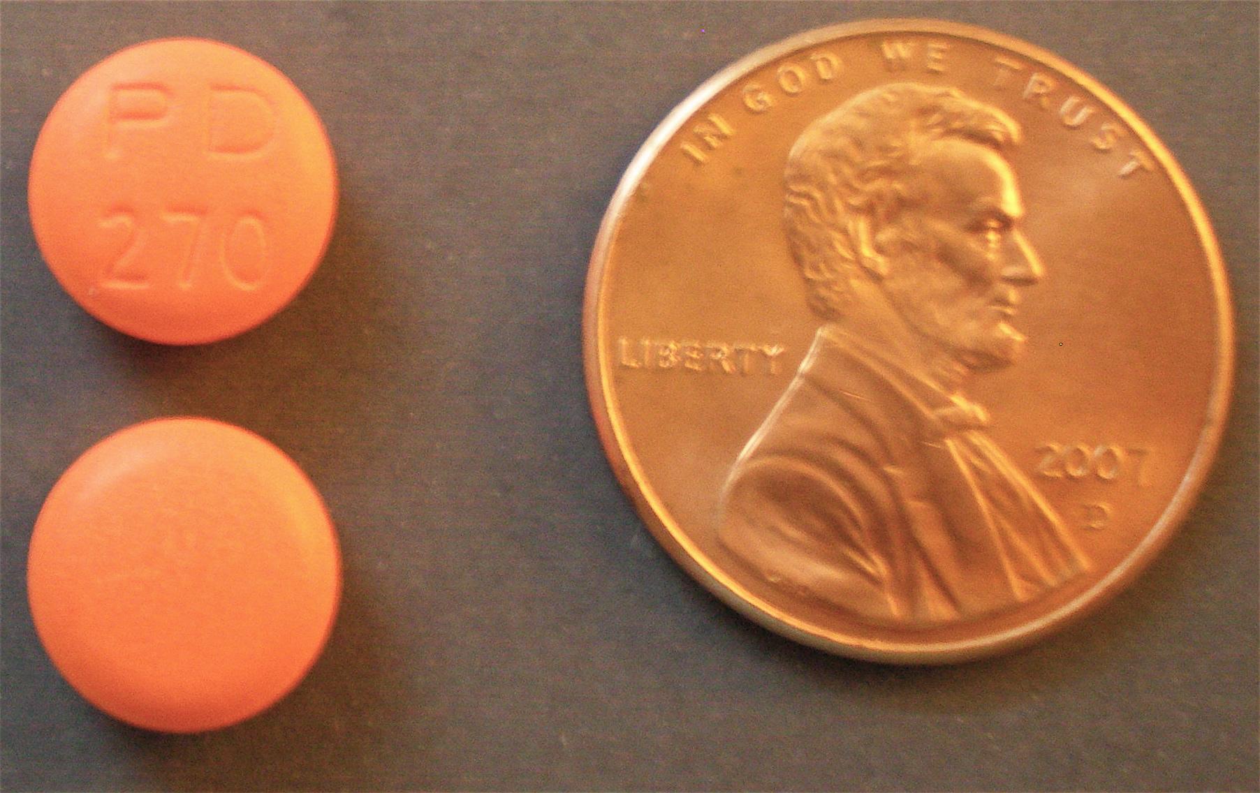 orange capsule c...Adderall Pill