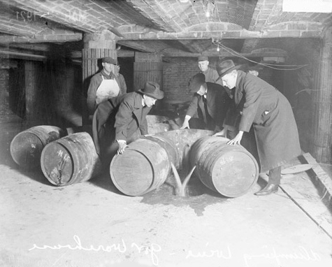 Prohibition agents destroying barrels of alcohol, 1921