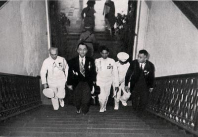 President Manuel L. Quezon (1935-1944) climbs up the grand staircase of Malacañan Palace with aide-de-camp Col. Manuel Nieto and Presidential Guard Battalion Commander Col. Manzano.