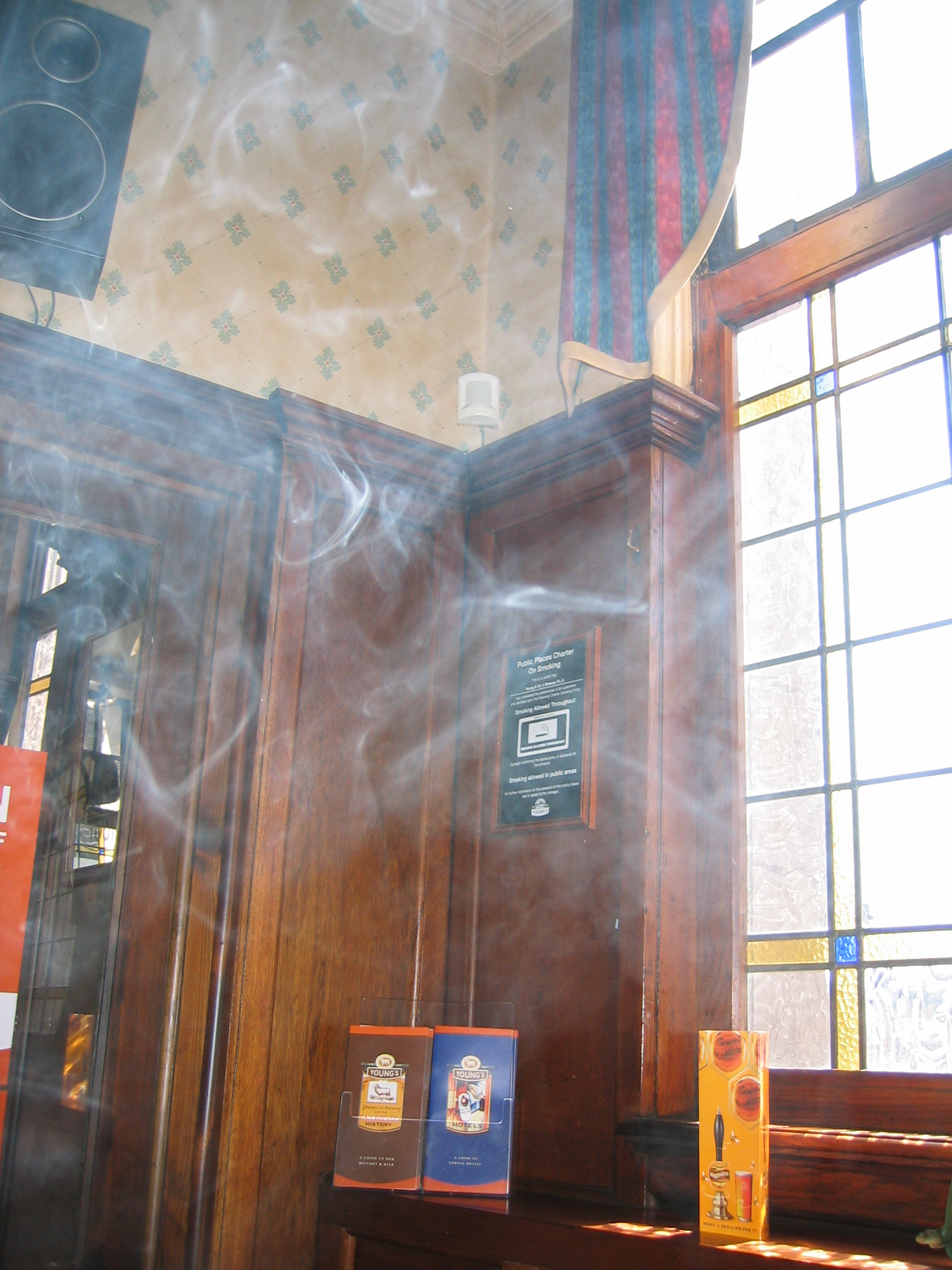 carex photo smoke by window in a pub