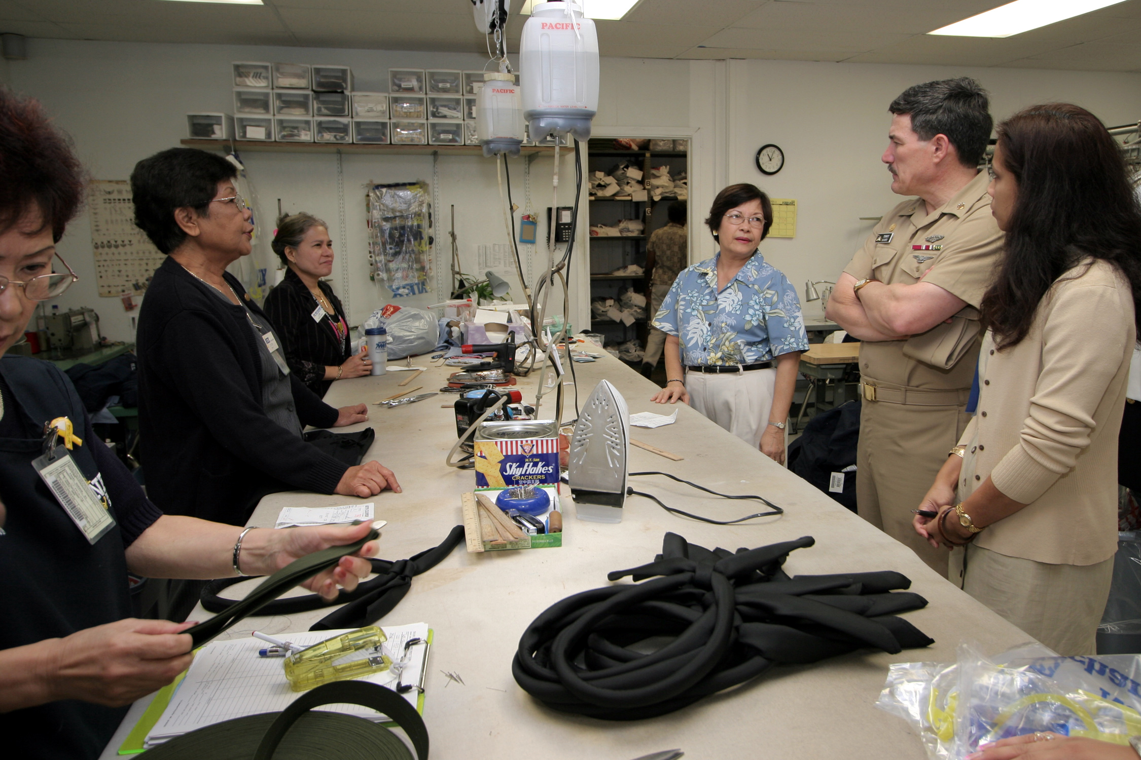 ... receives feedback from tailors at the Navy Exchange Uniform Shop.jpg