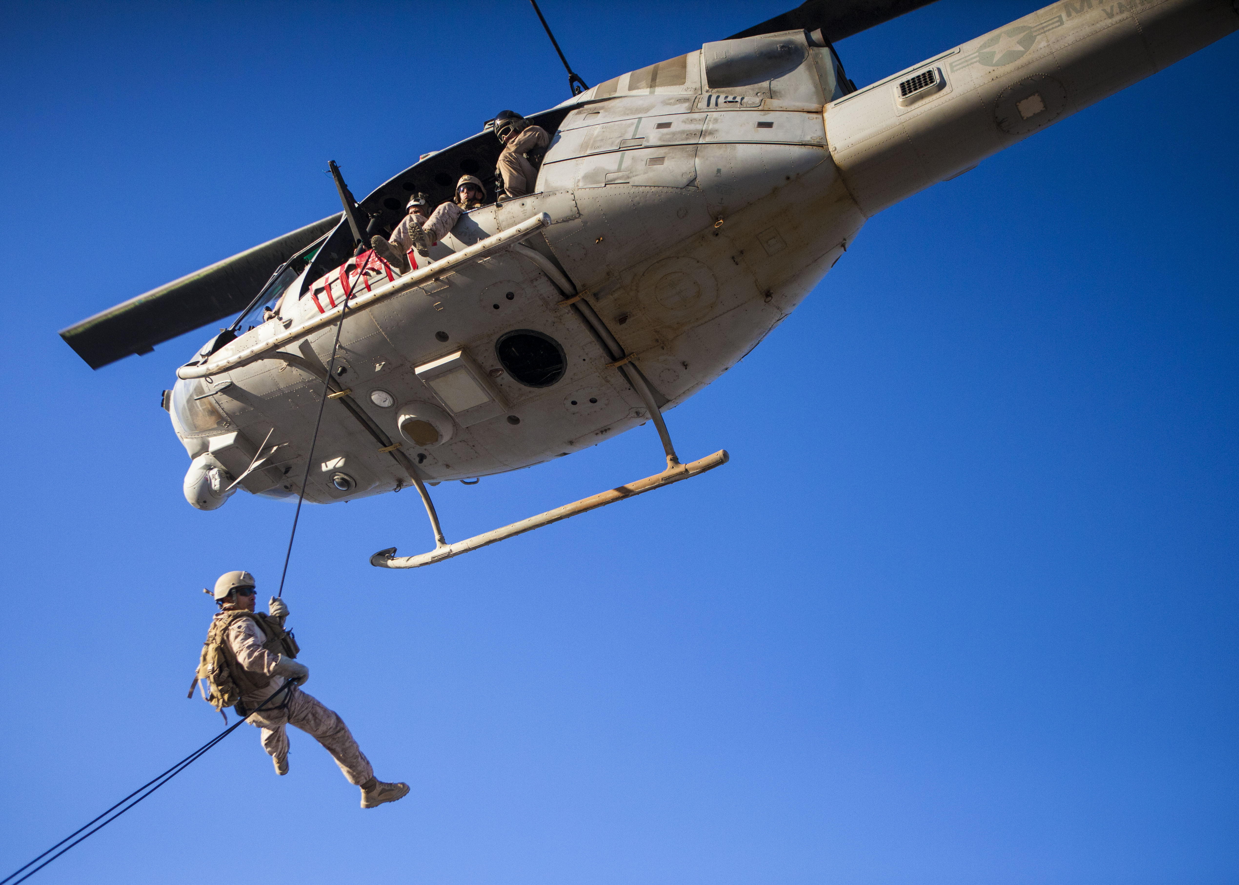 File:A_U.S._Marine,_bottom,_with_the_26th_Marine_Expeditionary_Unit's_Maritime_Raid_Force_rappels_from_a_UH 1N_Iroquois_helicopter_assigned_to_Marine_Medium_Tiltrotor_Squadron_(VMM)_266_during_a_helicopter_rope_130611 M SO289 017 on Central Unit