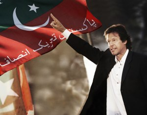 Picture of imran khan infront of the flag of P...