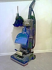 Feather duster, dustpan and broom, and upright...