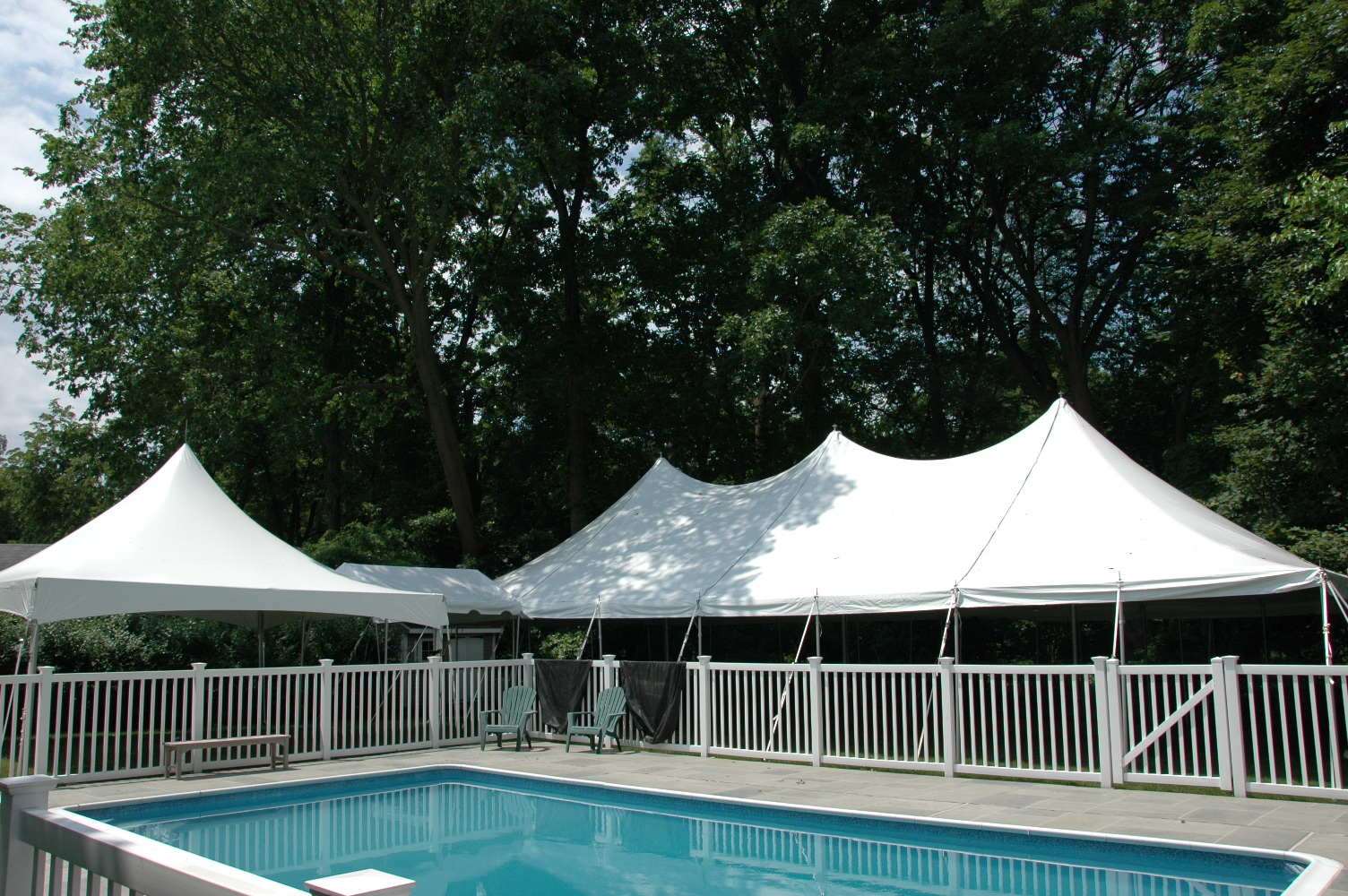 file tents set up for party in the backyard around the pool jpg