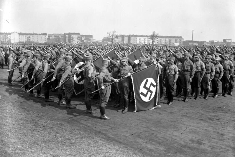 Nazi stormtroopers salute their colours, Tempelhof Airfield, Berlin, 1933