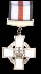 Conspicuous Gallantry Cross on black background