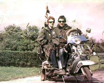 An image from the movie Quadrophenia (1979) of two mid-1960s mods on a customised scooter