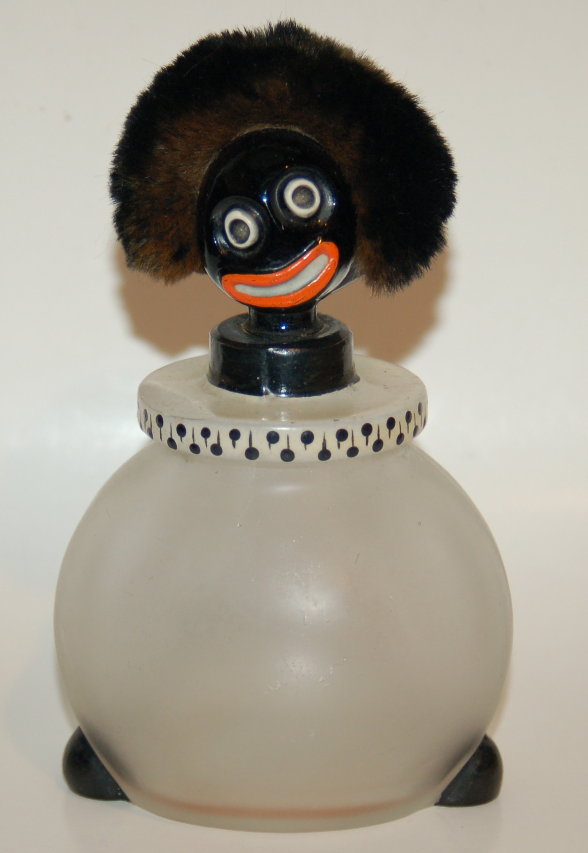 Bottle with golliwog head top