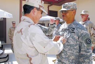 File:Rear Admiral Harry Harris promotes US Army Captain Anthony John in Guantanamo.jpg