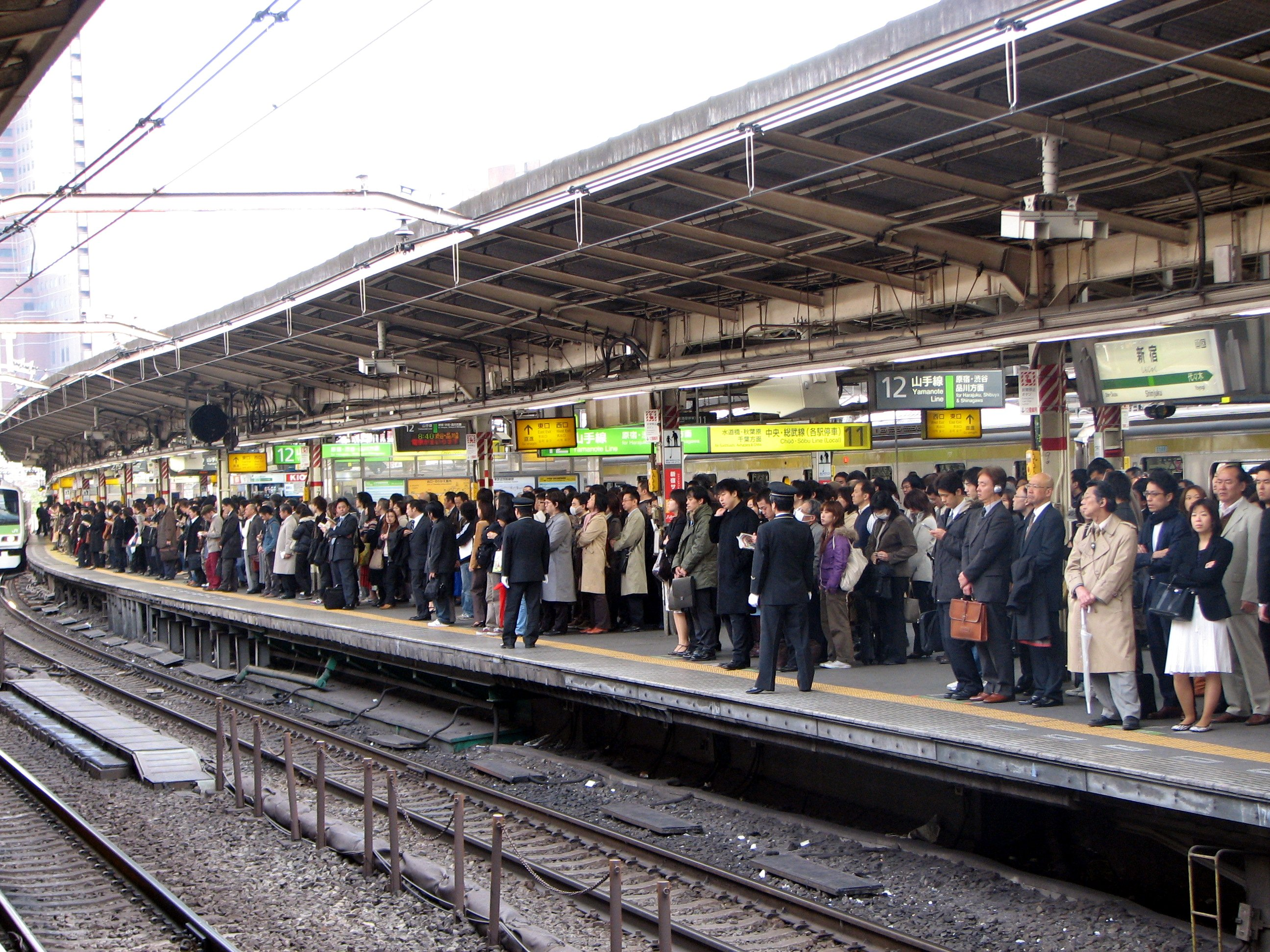 descriptive essay on railway station in rush hour A train station or railway station (also called a railroad station, rail station, or  depot) is a place where  at peak times, there is one train every 13 seconds  there.