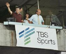 Skip Caray and Pete Van Wieren acknowledging fans at a game in 1983.