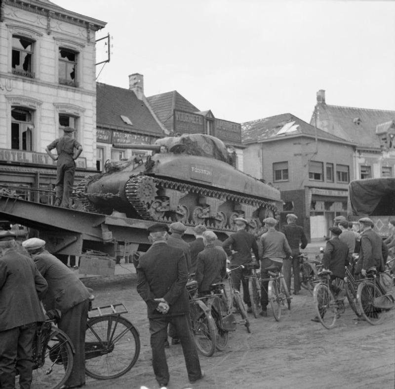 A Sherman of the 4th CLY loaded onto a tank transporter