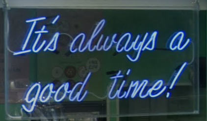 Blue Neon sign in a pastry shop