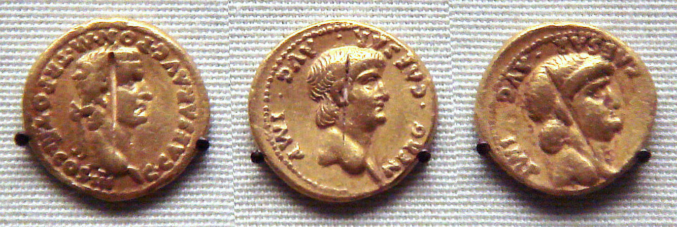 Roman_gold_coins_excavated_in_Pudukottai_India_one_coin_of_Caligula_31_41_and_two_coins_of_Nero_54_68.jpg