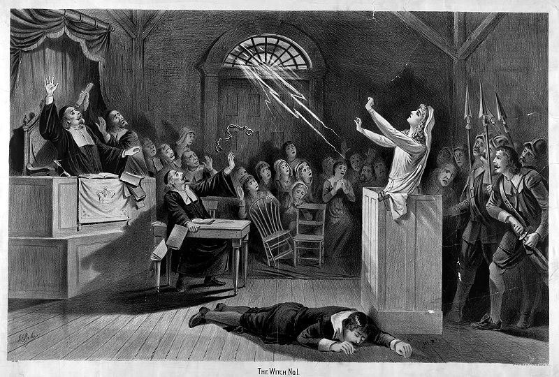A lithograph of a witch trial.