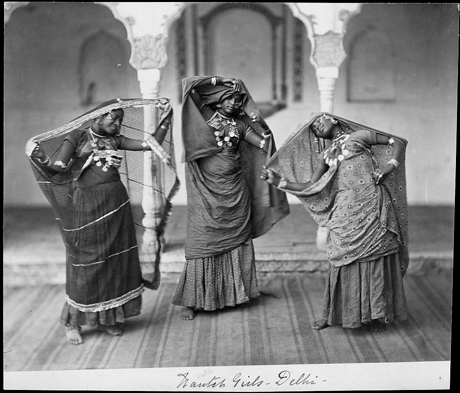 "A Photo of three Nautch girls performing together, captioned ""Nautch Girls, Delhi"""