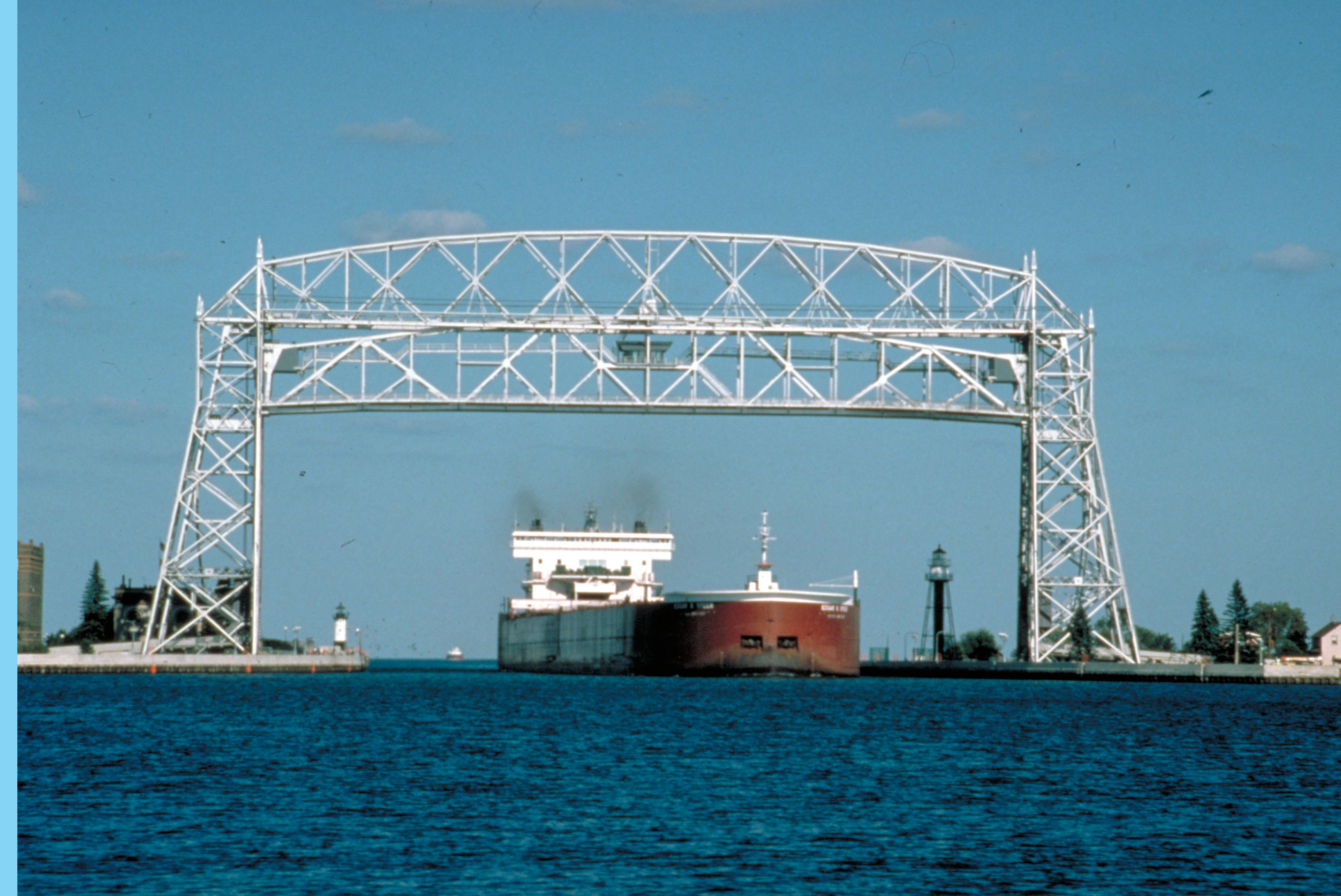 The aerial lift bridge rises to allow ships to pass under it