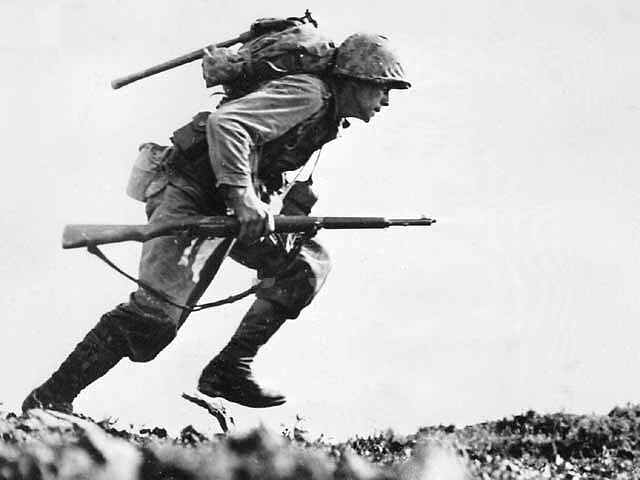 US_Marine_charges_through_Japanese_machine_gun_fire_on_Okinawa.jpg