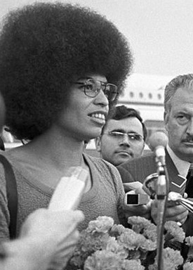Political activist, academic scholar, and author Angela Davis is featured in the film through both footage and contemporary voice commentary.